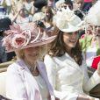 Kate Middleton et Camilla Parker Bowles lors de la cérémonie de l'Ordre de la Jarretière au château Windsor, à Londres, le 18 juin 2012