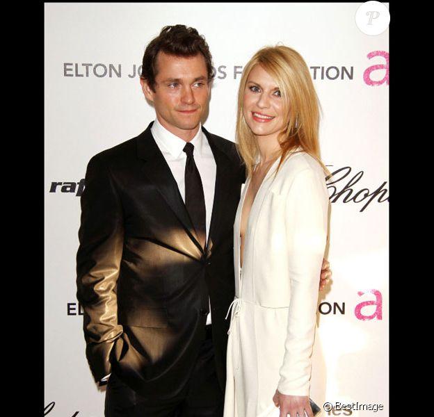 Claire Danes et son mari Hugh Dancy posent lors de la soirée Elton John contre le sida en mars 2011 à Los Angeles