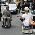 Mimie Mathy et Philippe Caroit sur le tournage de Joséphine, Ange gardien, à Paris, le 19 juin 2012