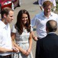 Kate Middleton, le prince William et le prince Harry, ambassadeurs de la Team GB pour les JO de Londres 2012, inauguraient ensemble le projet de formation de coachs Coach Core, le 26 juillet 2012 au Bacon College de Rotherhithe (sud-est de Londres).