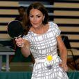 'Il faut se méfier d'elle quand elle a une raquette en main', dit d'elle le prince William ! Kate Middleton et les princes William et Harry, ambassadeurs de la Team GB pour les JO de Londres 2012, inauguraient ensemble le projet de formation de coachs Coach Core, le 26 juillet 2012 au Bacon College de Rotherhithe (sud-est de Londres).