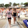Christian Audigier, en vacances à St-Tropez avec sa compagne Nathalie Sorensen, le vendredi 27 juillet 2012.