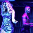 """Clara Morgane met le feu lors du concert """"ON THE BEACH"""" à Liège durant lequel elle s'est produite aux côtés du DJ Jey Didarko, son mari, et de ses danseurs Harmony et Fabso le 2 août 2012."""