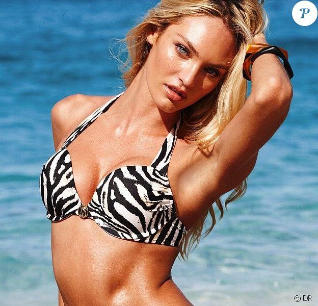 Candice Swanepoel, sexy dans un bikini zébré pour Victoria's Secret.