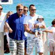 Elton John et son mari David Furnish et leur fils Zachary au Club 55 à Ramatuelle le 18 août 2012