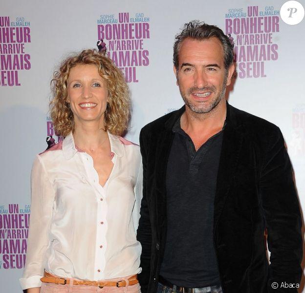 Alexandra Lamy et Jean Dujardin lors de l'avant-première d'Un bonheur n'arrive jamais seul le 15 juin 2012