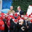 La princesse Charlene de Monaco était radieuse lors du Noël des enfants au palais princier, le 12 décembre 2012.
