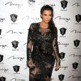 Kim Kardashian, enceinte, et son petit ami Kanye West fêtent le Nouvel An à la boîte de nuit 1 OAK au Mirage à Las Vegas, le 31 décembre 2012.