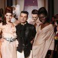 Julien de Secret Story 6 défile pour la collection Haute Couture printemps-été du couturier Eric Tibusch à l'hôtel d'Evreux in Paris, le 21 janvier 2013