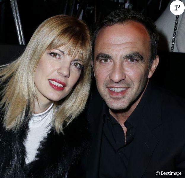 Nikos Aliagas et Tina Grigoriou assistent au défilé prêt-à-porter automne-hiver 2013 de Jean Paul Gaultier à la Salle Wagram. Paris, le 2 mars 2013.