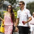 Jenson Button et sa petite amie Jessica Michibata avant le Grand-Prix de Malaisie à Kuala Lumpur le 24 mars 2013.