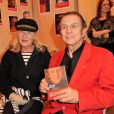 Roland Giraud et son épouse Maaike Jansen - 33eme édition du Salon Du Livre à Paris, le 23 mars 2013.
