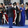 Maxima et Willem-Alexander des Pays-Bas arrivant pour la prestation de serment du roi, le 30 avril 2013 à la Nouvelle Eglise (Nieuwe Kerk) d'Amsterdam.