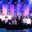 Céline Dion et Johnny Hallyday chantent L'Envie sur le plateau Les 500 choristes sur TF1, en novembre 2005.