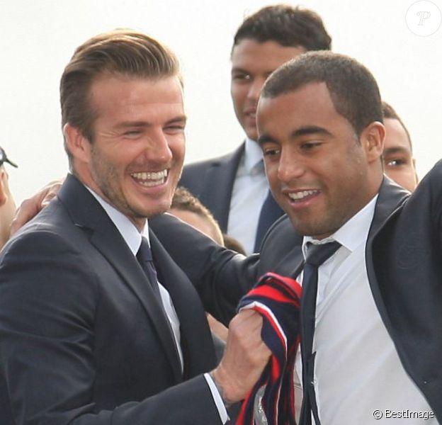 David Beckham et Lucas quittent le Parc des Princes pour fêter le titre de Champion de France au Trocadero à Paris le 13 mai 2013.