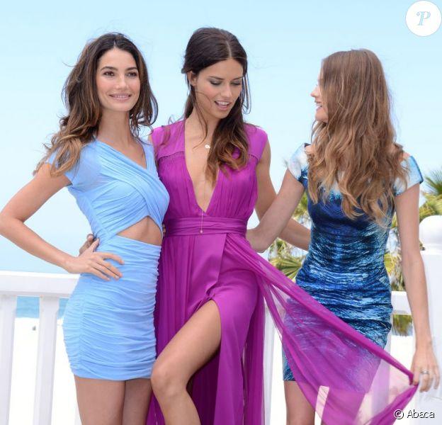 Lily Aldridge, Adriana Lima et Behati Prinsloo, trop ultra sexy pour dévoiler les noms de la liste What is Sexy et lancer la collection de soutien-gorges Multi-Way de Victoria's Secret à l'hôtel Shutters On The Beach. Santa Monica, le 14 mai 2013.