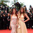 Delphine Wespiser et Laury Thilleman à la montée des marches de Jeune Et Jolie, premier film en compétition, au Palais des Festivals de Cannes, le 16 mai 2013.