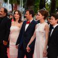 Frédéric Pierrot, Géraldine Pailhas, François Ozon, Marine Vacth et Fantin Ravat lors de la montée des marches de Jeune Et Jolie, premier film en compétition, au Palais Des Festivals de Cannes, le 16 mai 2013.