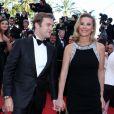Laurence Ferrari et son mari Renaud Capuçon à la montée des marches du film Le Passé, lors du 66e Festival du film de Cannes, le 17 mai 2013.
