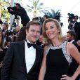 La journaliste Laurence Ferrari et son mari Renaud Capuçon à la montée des marches du film Le Passé, lors du 66e Festival du film de Cannes, le 17 mai 2013.