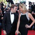 Laurence Ferrari et son mari Renaud Capuçon, complices, à la montée des marches du film Le Passé, lors du 66e Festival du film de Cannes, le 17 mai 2013.