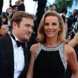 Laurence Ferrari et son époux Renaud Capuçon à la montée des marches du film Le Passé, lors du 66e Festival du film de Cannes, le 17 mai 2013.