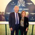 Pierre Dhostel et sa femme Caroline à la soirée de lancement du Prix de Diane Longines 2013 au Pavillon Gabriel, le 22 mai 2013.