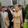 La princesse Charlene de Monaco accompagnée de deux des ambassadeurs de sa fondation, Byron Kelleher et Rick Yune au Yacht Club de Monaco le 24 mai 2013