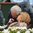 Dominique Strauss-Kahn et sa compagne Myriam L'Aouffir dans les tribunes du tournoi de Roland-Garros 2013 pour la finale opposant Rafael Nadal à David Ferrer, à Paris le 9 juin 2013.