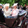 Le prince Harry avec Kate Middleton, enceinte et en Alexander Mc Queen, et Camilla Parker Bowles le 15 juin 2013, lors de la procession de la famille royale à l'occasion de la parade Trooping the Colour, à la gloire des forces armées et de l'anniversaire de la souveraine, Elizabeth II.