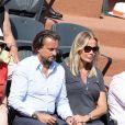 Henri Leconte et sa femme Florentine dans les tribunes de Roland-Garros le 7 juin 2013