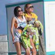 Hailey Baldwin, la fille de Stephen Baldwin et nièce d'Alec se baigne avec une amie à Miami, le 24 Juin 2013.