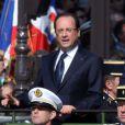 François Hollande et l'amiral Edouard Guillaudau défilé du 14 juillet 2013 à Paris.