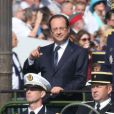 Francois Hollande et l'amiral Edouard Guillaudau défilé du 14 juillet 2013 à Paris.