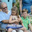 Christian et Isabella avec le couple royal. La famille royale de Danemark en séance photo le 26 juillet 2013 pour les médias dans le parc du château de Grasten, résidence d'été royale. Autour de la reine Margrethe II et du prince Henrik, le prince Frederik et la princesse Mary, et le prince Joachim et la princesse Marie, avec tous leurs enfants, ainsi que la princesse Benedikte, le prince Gustav et la princesse Alexandra de Sayn-Wittgenstein-Berleburg, et la reine Anne-Marie de Grèce étaient rassemblés.