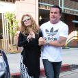 AnnaLynne McCord, totalement déboussolée et étourdie à la sortie du dentiste, est accompagnée par son compagnon très musclé Dominic Purcell, à Beverly Hills, le 26 juillet 2013