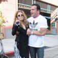AnnaLynne McCord, totalement déboussolée et étourdie à la sortie du dentiste, est accompagnée par son compagnon Dominic Purcell, très en forme, à Beverly Hills, le 26 juillet 2013
