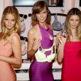 Erin Heatherton, Karlie Kloss et Behati Prinsloo fêtent le lancement de la collection Body By Victoria de Victoria's Secret, dans la boutique de la marque, à SoHo. New York, le 30 juillet 2013.