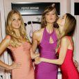 Erin Heatherton, Karlie Kloss et Behati Prinsloo, trois bombes en robes Hervé Léger pour célébrer la sortie de la collection Body By Victoria de Victoria's Secret, dans la boutique de la marque, à SoHo. New York, le 30 juillet 2013.