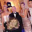 Brian Rennie, directeur de la création de Basler, entouré de mannequins dont Lena Gercke, à l'Hôtel Hermitage de Monte-Carlo lors de la soirée de bienfaisance pour les 40 ans du Club Allemand International de Monaco, marquée par un défilé de la marque Basler, le 30 juillet 2013. Photo BestImage/Frederic Nebinger