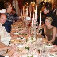 Le prince Albert II et sa femme la princesse Charlene de Monaco lors du dîner de la soirée de bienfaisance pour les 40 ans du Club Allemand International de Monaco, marquée par un défilé de la marque Basler, le 30 juillet 2013 à l'Hôtel Hermitage de Monte-Carlo. Photo BestImage/Frederic Nebinger