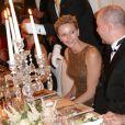 La princesse Charlene de Monaco en conversation avec le directeur de la création Brian Rennie lors du dîner de la soirée de bienfaisance pour les 40 ans du Club Allemand International de Monaco, marquée par un défilé de la marque Basler, le 30 juillet 2013 à l'Hôtel Hermitage de Monte-Carlo. Photo BestImage/Frederic Nebinger