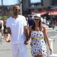 Tony Parker et sa fiancée Axelle Francine se promènent main dans la main à Saint-Tropez, le 20août 2013.
