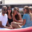 Tony Parker et Axelle Francine en vacances à Saint-Tropez avec des amis. Le 18 aout 2013.