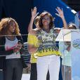 Devant une Serena Williams très attentive, Michelle Obama prend la parole à l'occasion du Arthur Ashe Kids' Day à New York, le 24 août 2013.
