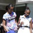 Sasha et Malia Obama dans les tribunes pour le Arthur Ashe Kids' Day à New York, le 24 août 2013.
