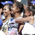 Michelle Obama et ses filles, Sasha et Malia, dans les tribunes pour le Arthur Ashe Kids' Day à New York, le 24 août 2013.