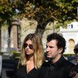 Michael Youn et sa compagne Isabelle Funaroaux obsèques de Pierre Huth à Nogent-sur-Marne le 30 août 2013.