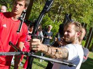 M. Pokora : Le séduisant 'Robin des bois' s'applique au tir à l'arc, bien coaché