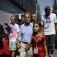 Luca Cordero di Montezemolo et sa fille dans les travées du Grand Prix d'Italie à Monza, le 8 septembre 2013
